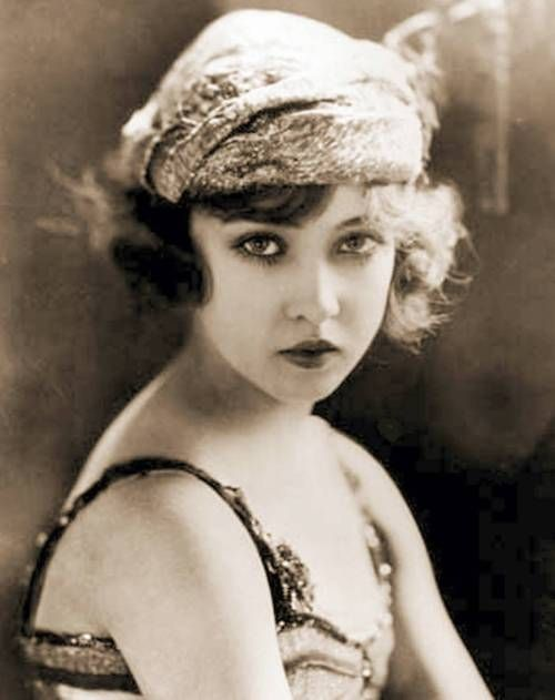 Young movie star Doris Eaton Travis -  looking directly into camera with bandana style hat