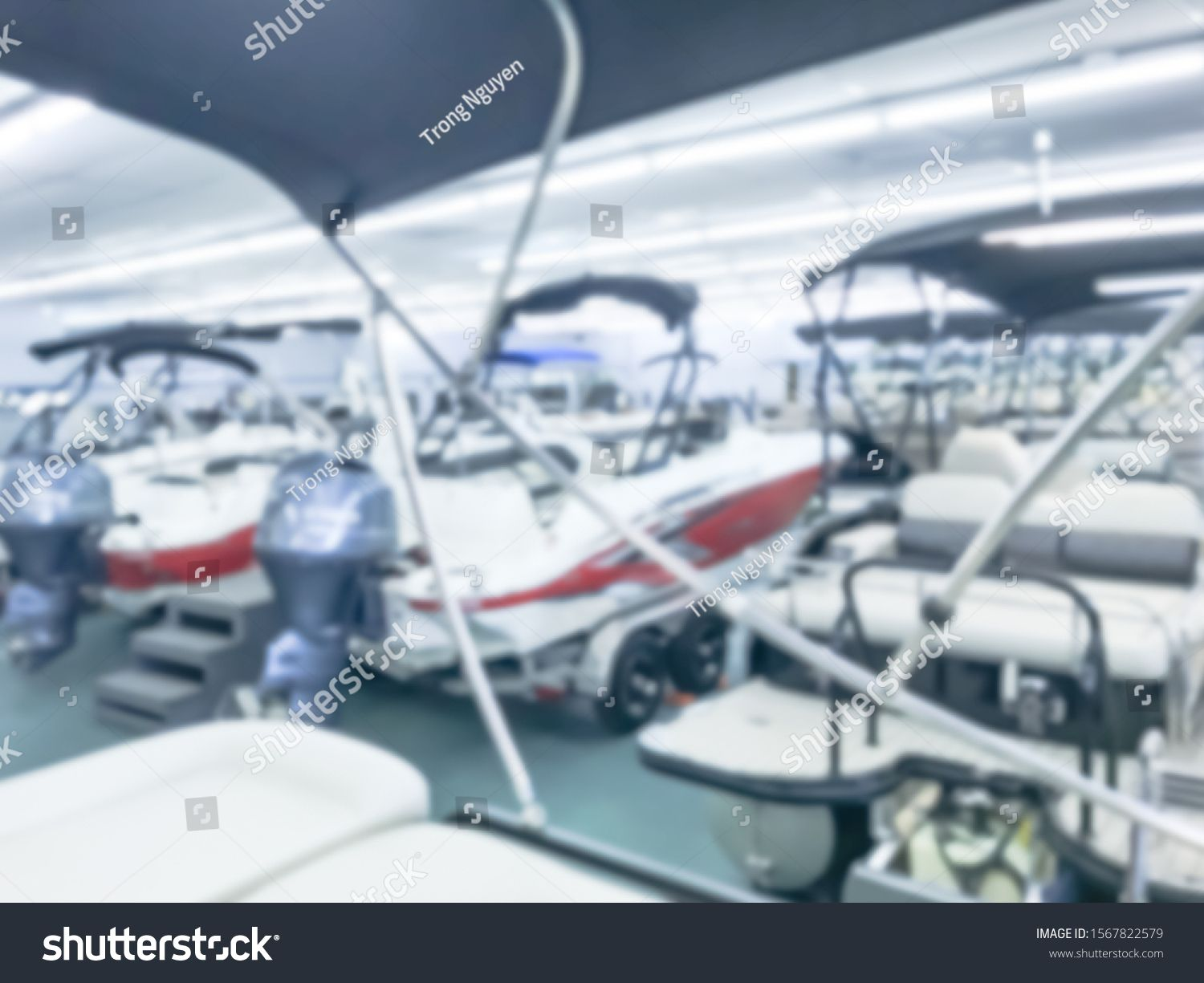 Motion blurred inside a large boat dealer selling variety of new and used boats near Dallas, Texas,