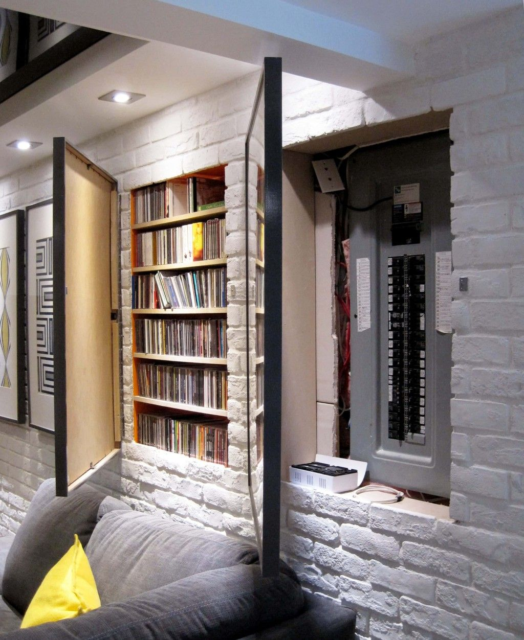 Using Framed Art Posters As Doors To Cover Storage Places
