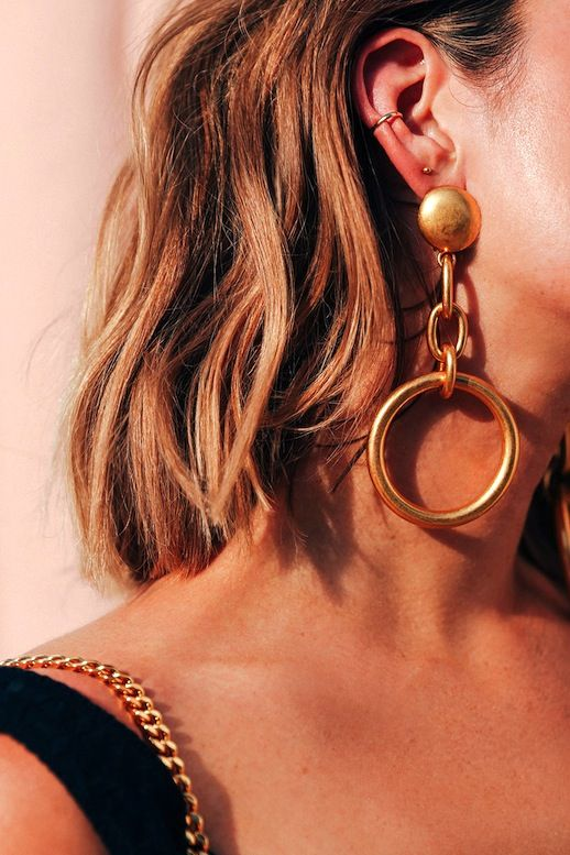 The statement earring is back in a big way and we are fully embracing it. A cool pair can bring any boring look to the next level which makes for an easy dressing trick that we can all get down with.