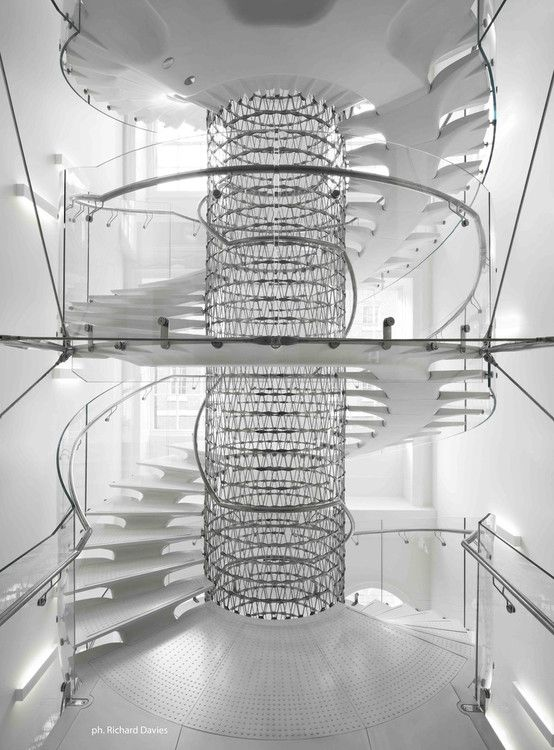 """Eva Jiricna Architects in Somerset House Trust The staircase resembles a twisting spinal column, each tread being a """"vertebrae"""" of this connetion system. The stair splits in seven segments, and winds around an internal supporting steel mesh. The steps and landings are connected to each other through a fixing system embedded in the elements. Each tread and landing are furnished with a thin molded non-slip pattern. LOC: Strand, London WC2R 1LA"""