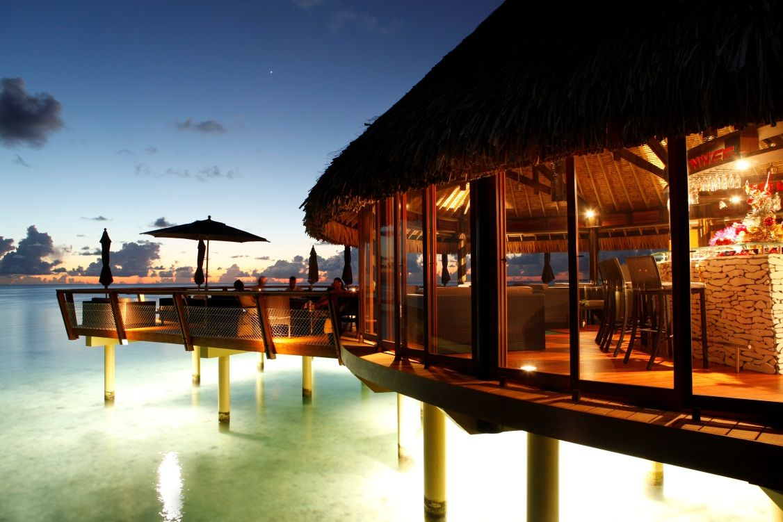 The Hotel Kia Ora Also Hosts An Overwater Bar Bungalow A Favorite For Travelers