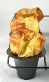 Yum-o! Neiman Marcus Popovers. The trick to these is to have warmed milk and eggs @ room temp- AND to let the batter rest.