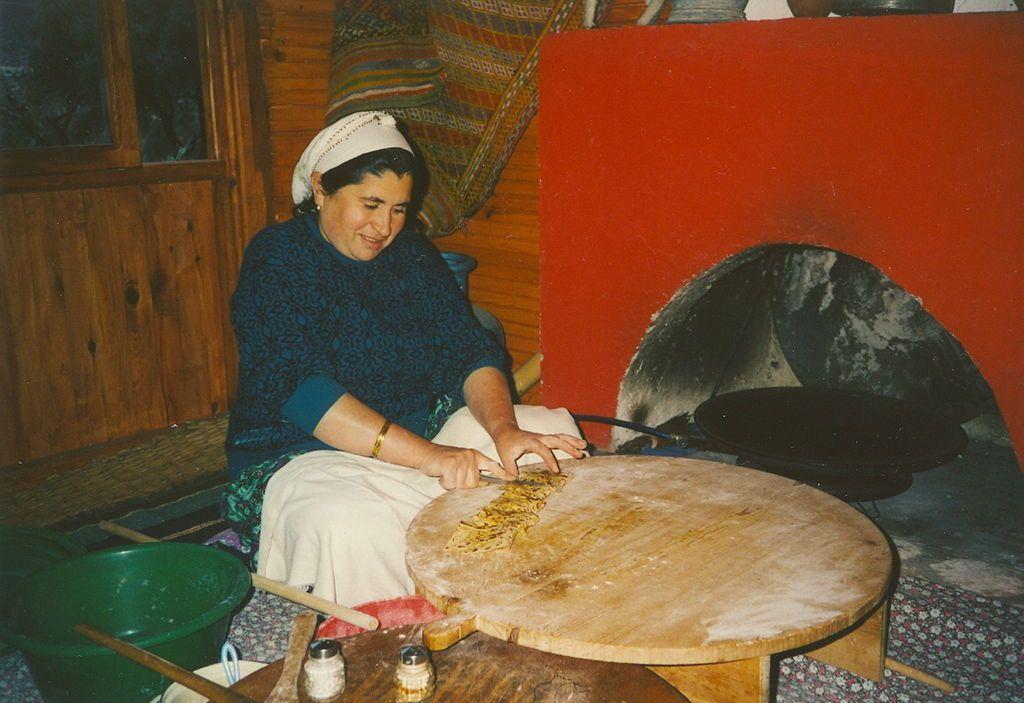 Preparing Peynirli Mantar Gozleme in a restaurant near Antalya