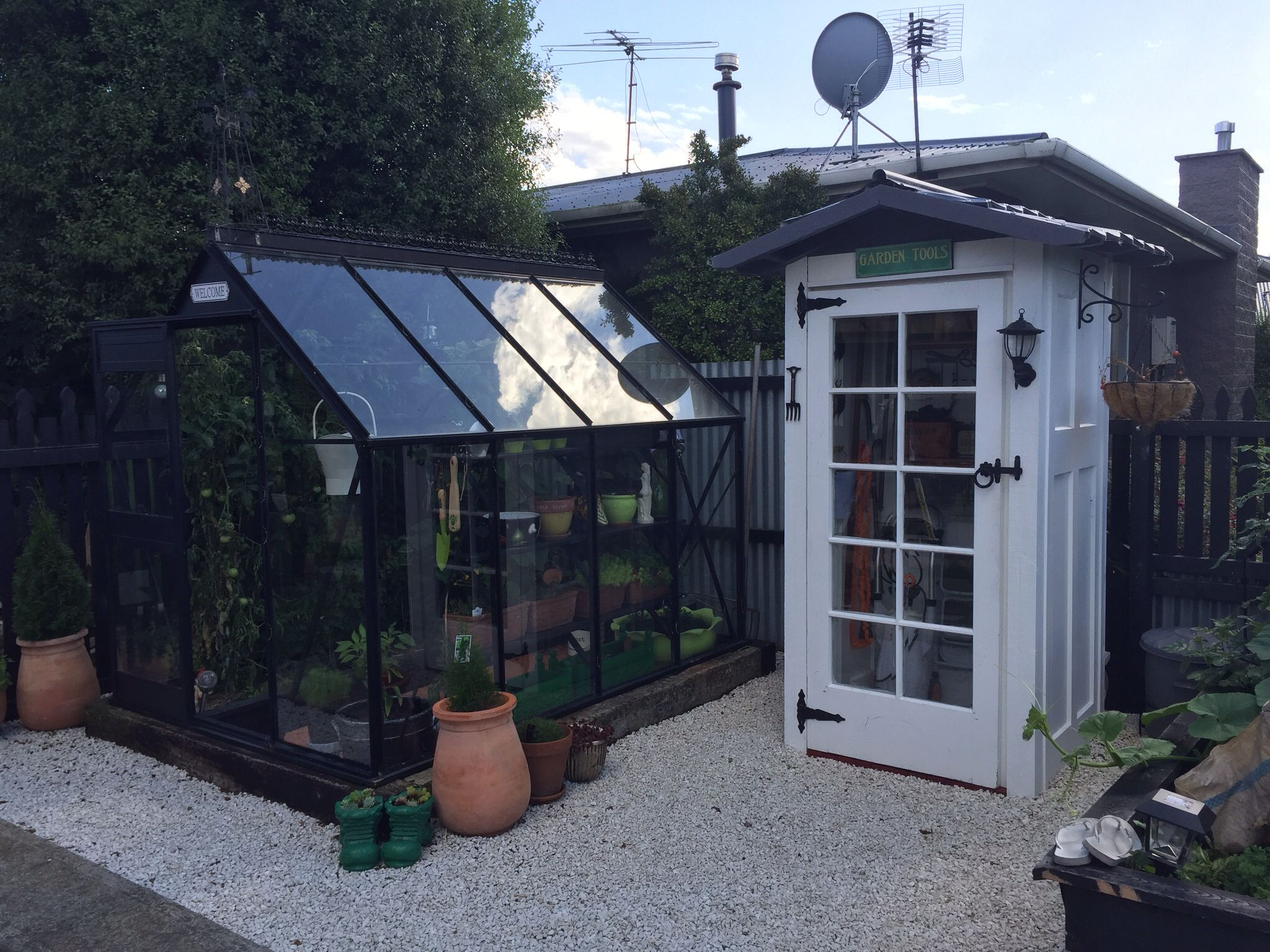 Glass house we painted and did up , she'd made with four doors I have a awesome husband making this happen for me