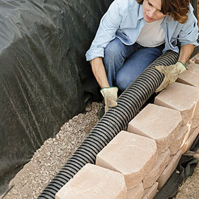 retaining wall drainage rock step build mat outlet