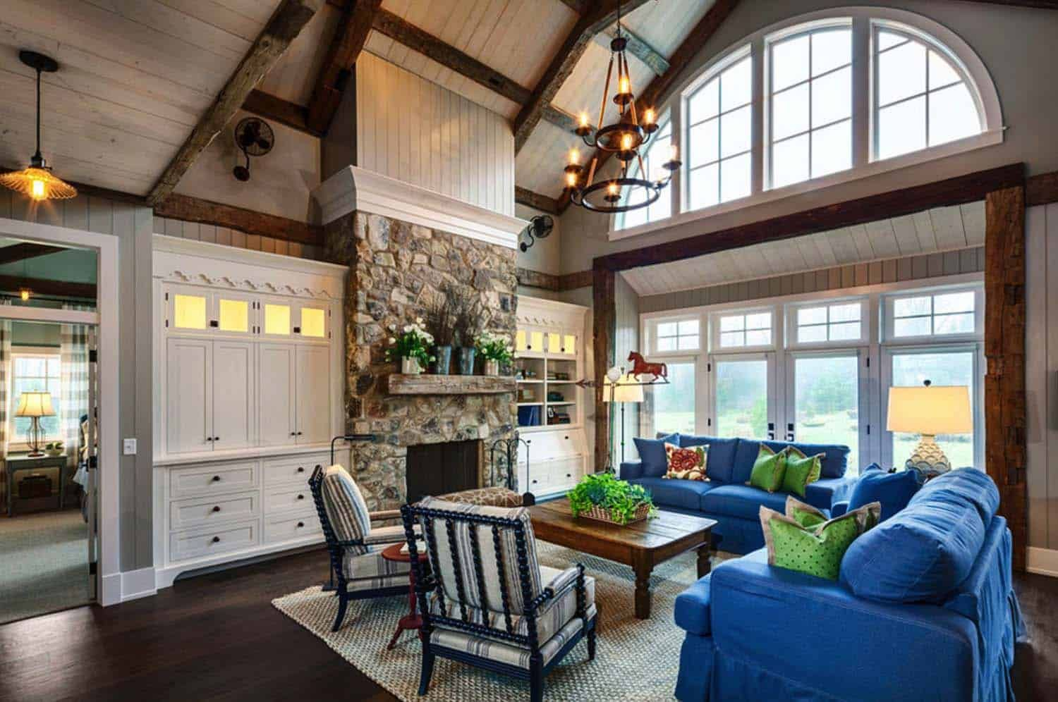 Inviting farmhouse style home surrounded by forest in