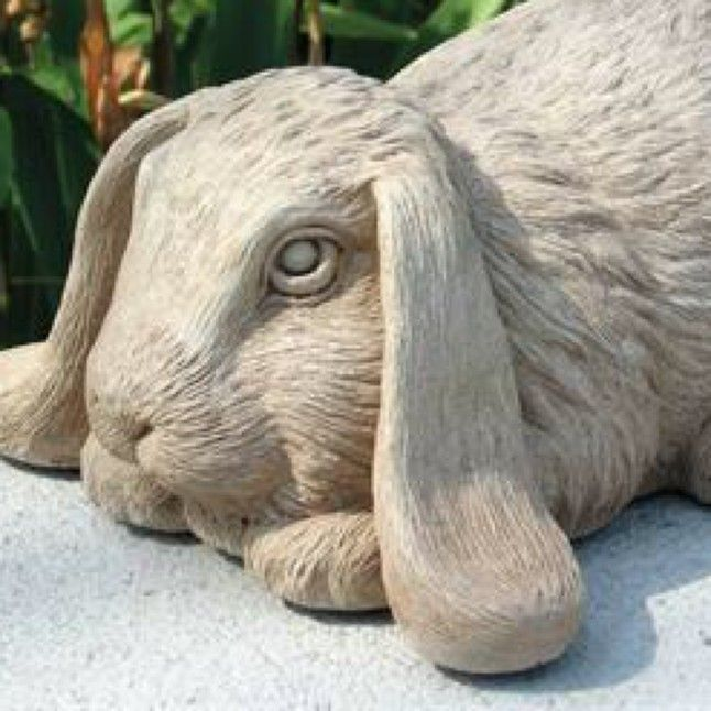 """Big Bashful Bunny - """"Just because he's big doesn't mean he isn't shy. This sculpture makes a striking accent on a deck or patio. Packed with personality, he will get plenty of attention, even if it makes him somewhat uncomfortable. This bunny figurine makes a delightful gift for the gardener.  Image is Natural, also available in Aged, Green, Terra Cotta and Designer White.  Dimensions 4 x 7.5 x 11 Composition"""