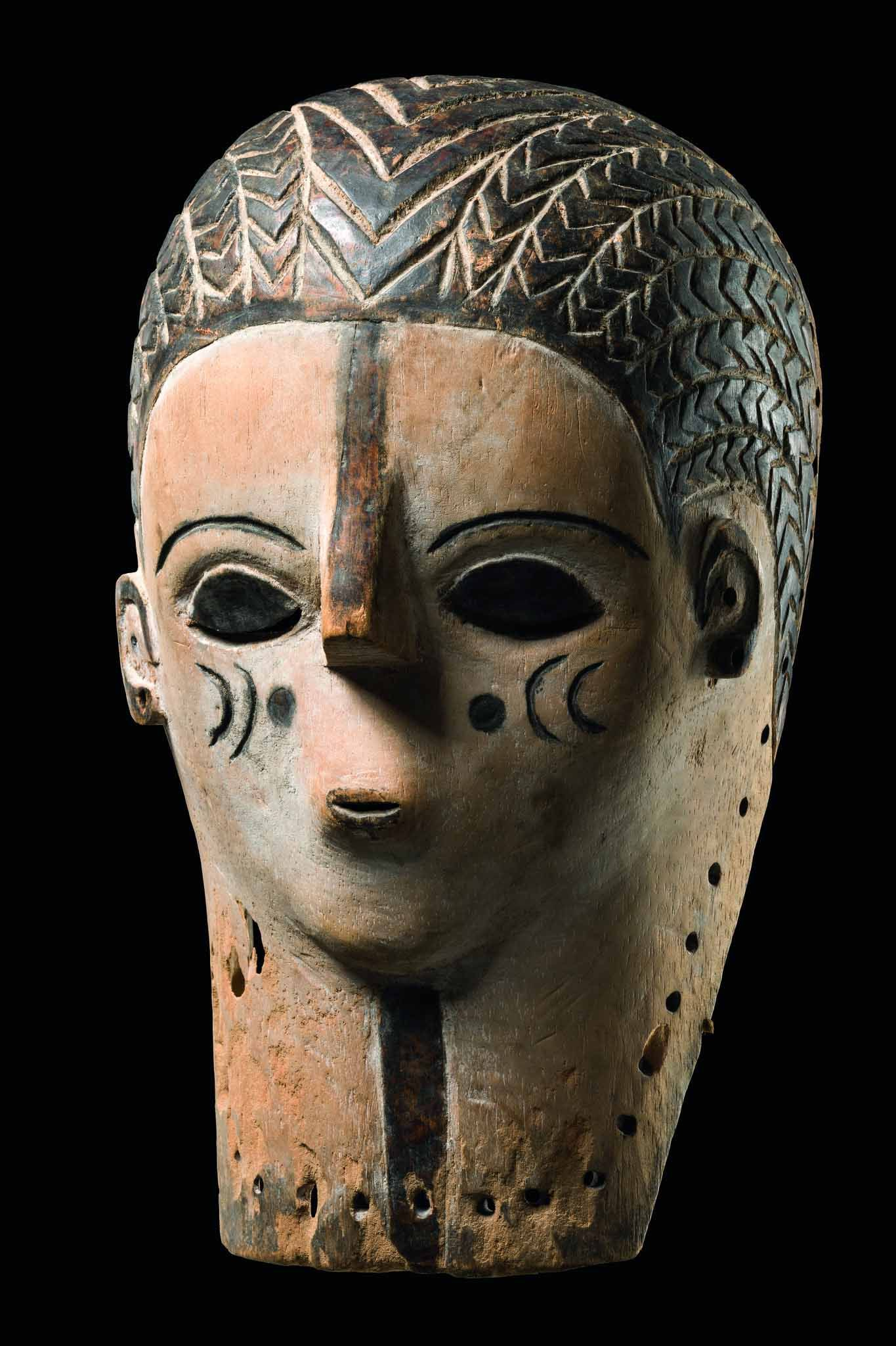 Africa | Female mask from the Songye or Zela people of DR Congo | Light wood, whitened with kaolin and black pigment accents