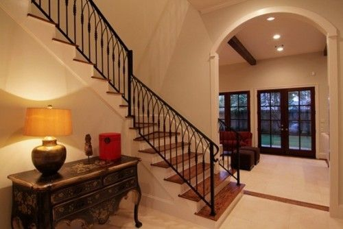 A Winding Stair With Wrought Iron Railing Traditional Staircase