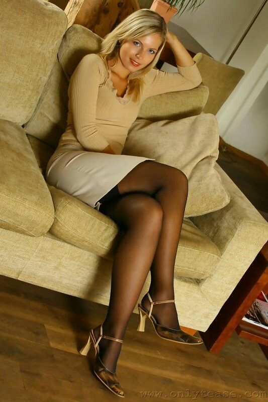 White Skirt Gold Top Sheer Black Stocking With Visible Tops And Ankle Strap High Heels
