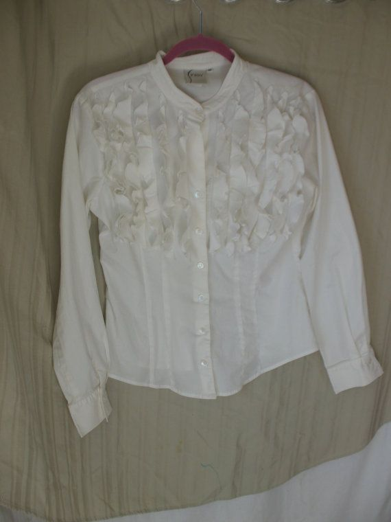 Womens size Sm-Med vintage 70s button down white blouse with ruffles.    I removed the large collar and big cuffs at the wrist. I left edges raw