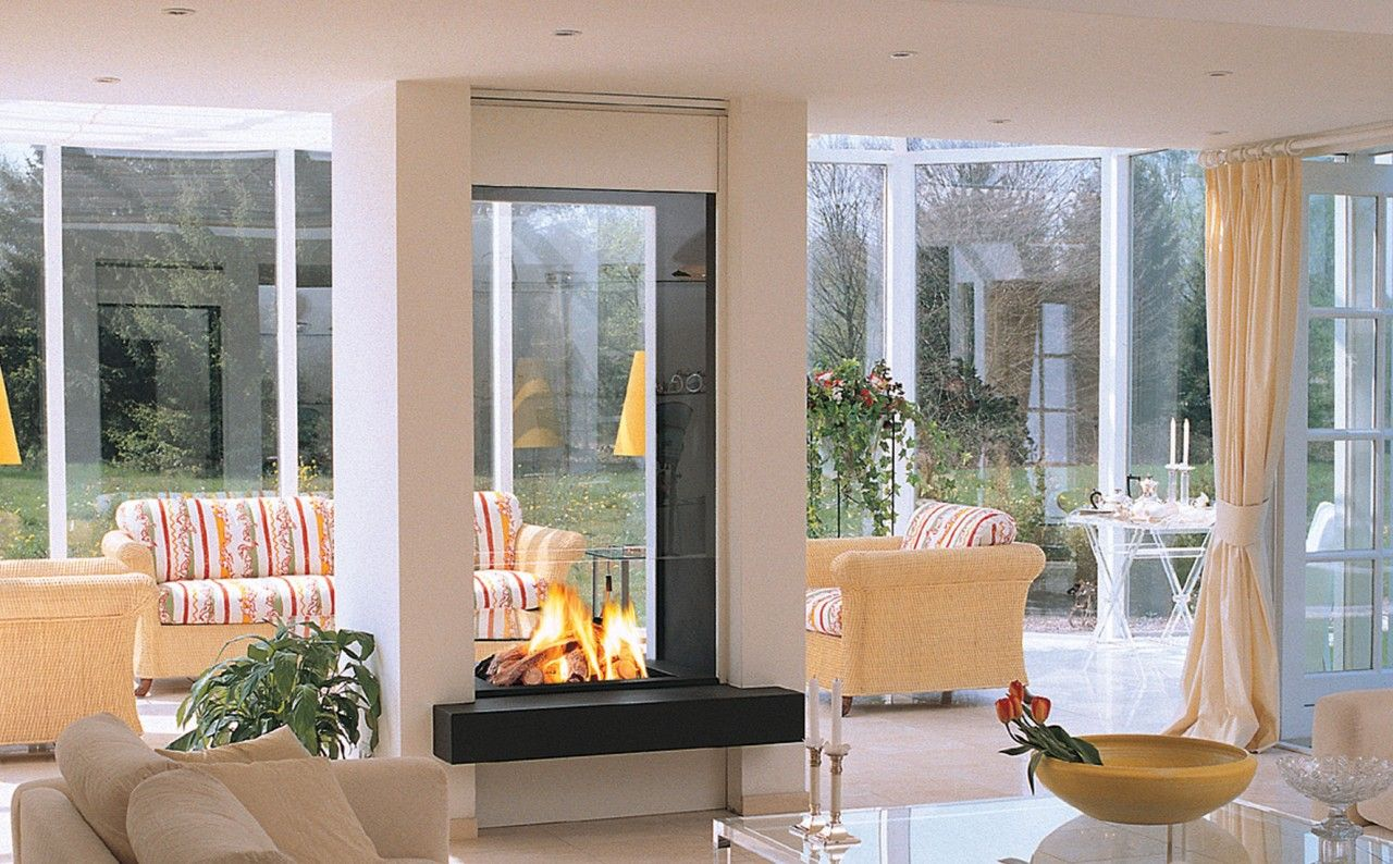 multifunction double sided gas fireplace is dividing two