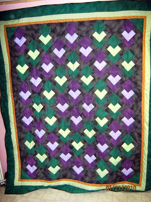 Try Batiks or Brighty Colored Fabrics to Create a Floating Squares Quilt: Floating Squares Quilt by QuietCabin
