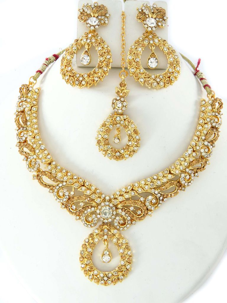 party wear jewellery designs  costume necklace set online shopping  Gold  color costume jewellery set at our online wholesale store. 917479a5e952c