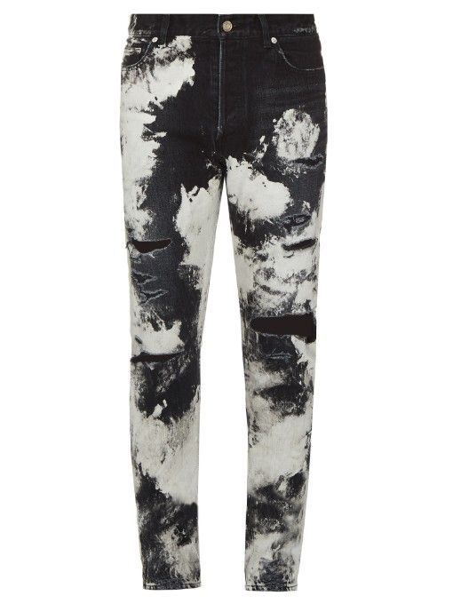 d53b5a23efe Saint Laurent's deeply bleached marble-effect black jeans are inspired by  LA's surf-rock