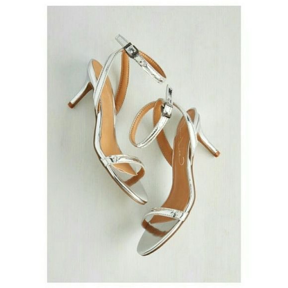 """""""Silver Lining"""" heels Pretty ankle strap sandals in a highly reflective metallic silver.   Heel measures apprx 3 inches. Shoes Heels"""