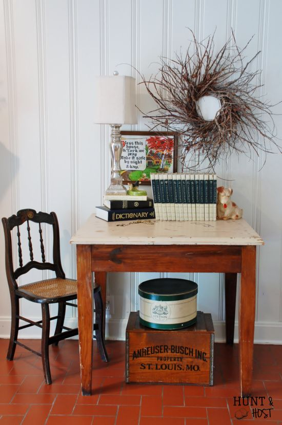 Hunt & Host Home Tour: Den Antique chair, junk store table, Round Top wreath, thrift store picture, Stetson hat box, vintage crate and a chalkware dog. All my favorites represented in one spot! www.huntandhost.com