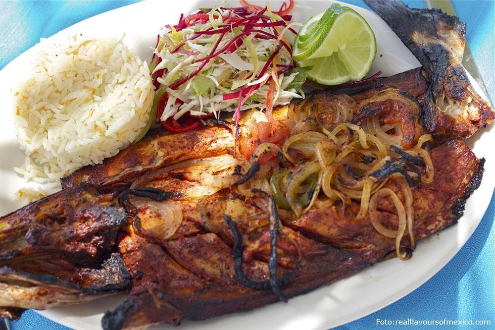 Cuando te bajes del #catamarán en #IslaMujeres,busca un restaurante en la playa y pide un delicioso pescado #TikinXic