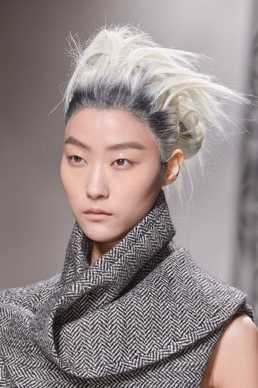 Wild hair with visible roots at Haider Ackermann. See more cool looks from #PFW here: