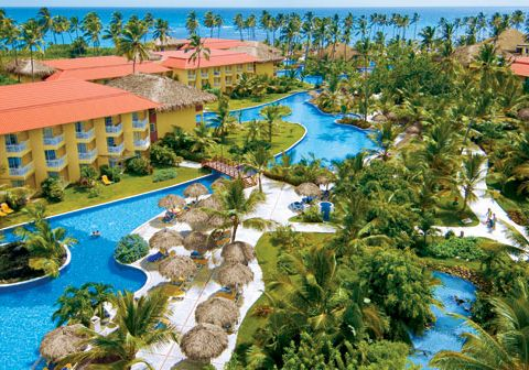 Dreams Punta Cana features a large free-form pool, thatched palapas and views of the Caribbean Sea.