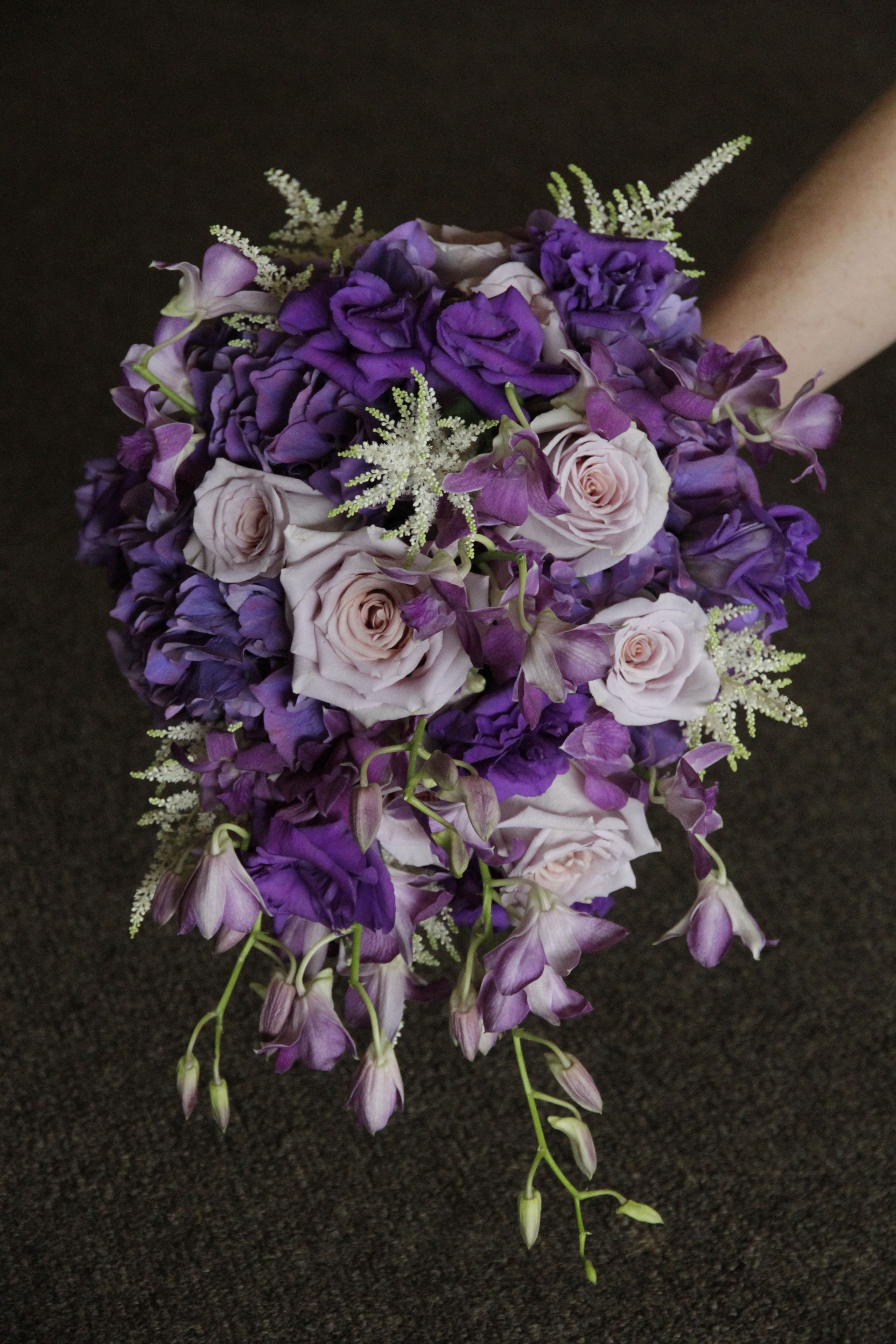 Purple Cascade Bouquet With Wedding Flowers Like Orchids Lisianthus And Astilbe Dallas