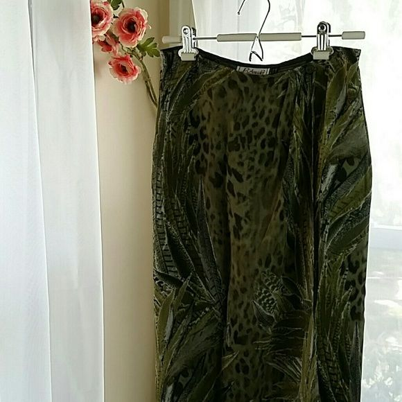 """Long Wrap Skirt Sheer with jungle cheetah pattern wrap skirt. Buttons on both sides of wrap. Dark green lining. 100% polester, fabric made in italy, dry clean only. Size 6, length approx. 36.5"""" L'Amadei Skirts"""