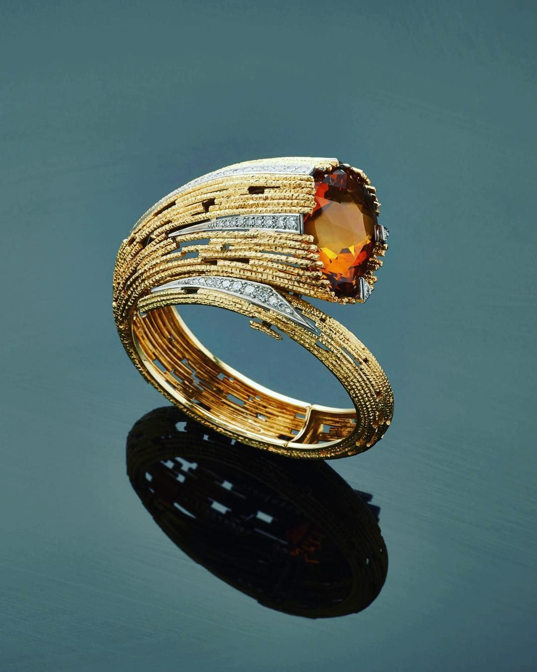 A gold textured wire diamond and citrine bracelet by Andrew Grima ...