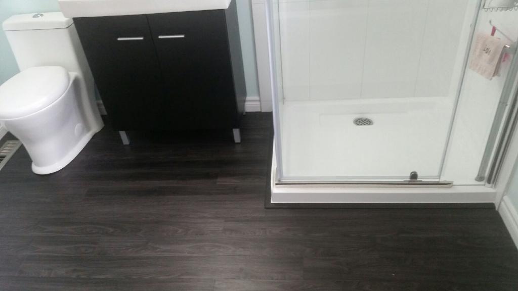 Charcoal Vinyl Plank In The Bathroom Supplied And Installed By Grand Floors Vinyl Plank Vinyl Plank Flooring Flooring