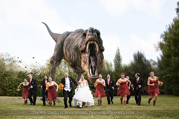 Fun Jurassic Park TREX Chasing Bridal Party Photo At The Jacksonville Zoo Gardens Wedding