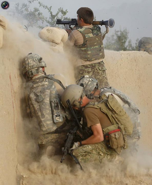 The War In Afghanistan An Afghan Army Soldier Fires A Rpg At Suspected Taliban Jihadis As Us Army Soldiers Crouc Us Army Soldier Army Soldier Afghanistan War