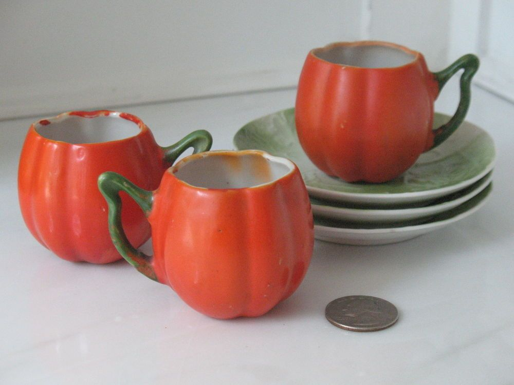 These would be so sweet incorporated into a Harvest themed or Halloween centerpiece,or place setting(wish there were more!)Antique Child's Pumpkin Shaped Tea Cups Saucers (3 Each) Germany