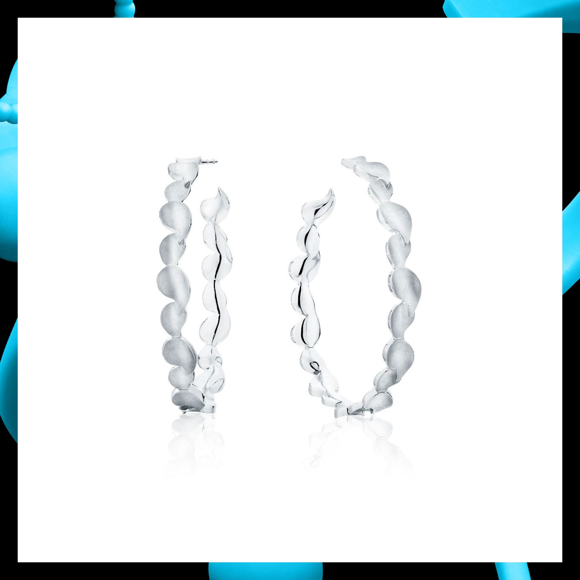 Dare To Embrace The Beauty Of These Silver Hoop Earrings