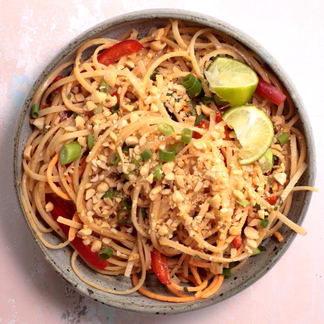 This bright and colorful Asian Noodle Salad is a gluten-free vegan meal that's filled with fresh vegetables and tossed in a spicy creamy nutty dressing   Asian Salad   Noodle Recipes   Healthy Noodles   #recipevideo #videorecipes #noodles #asianfood #healthyrecipes #salad #feelgoodfoodie via @feelgoodfoodie1