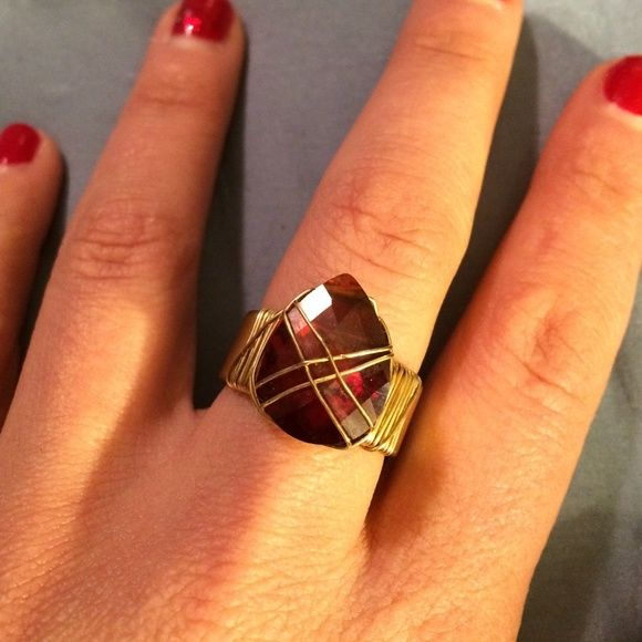 Cool Ring Cool gold tone and reddish stone ring around size 6/7 not exactly sure Accessories