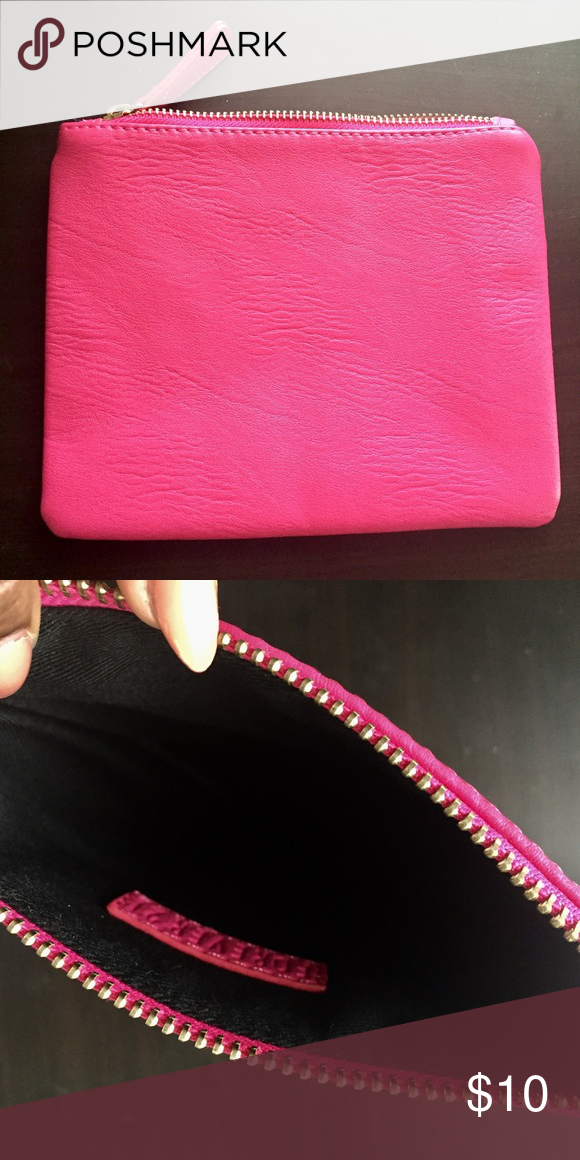 """Makeup/clutch bag Pink leather bag can be a clutch or makeup bag. There is no inside pocket. Length 6 1/4""""    Width 7 3/4"""" Bags Cosmetic Bags & Cases"""