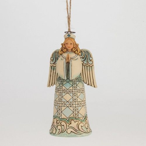 Jim Shore Nurse Angel Ornament - The Healing Hands Nurse Angel ornament honors care givers everywhere with a simple heartfelt depiction of the power of commitment and prayer.