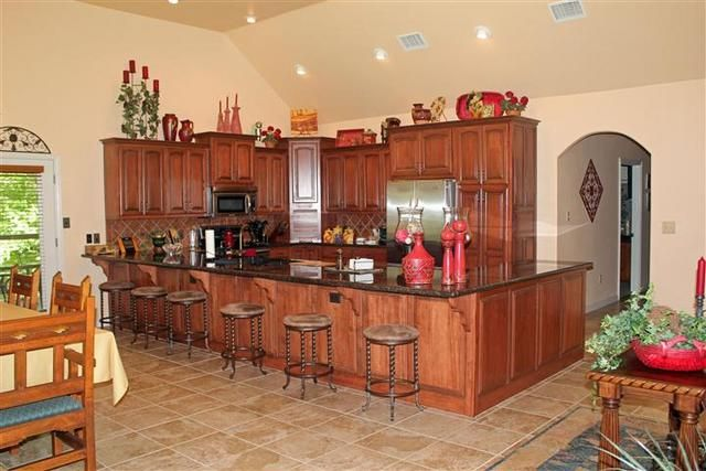 Custom maple cabinets with red oak stain and chocolate for Chocolate kitchen cabinets with stainless steel appliances