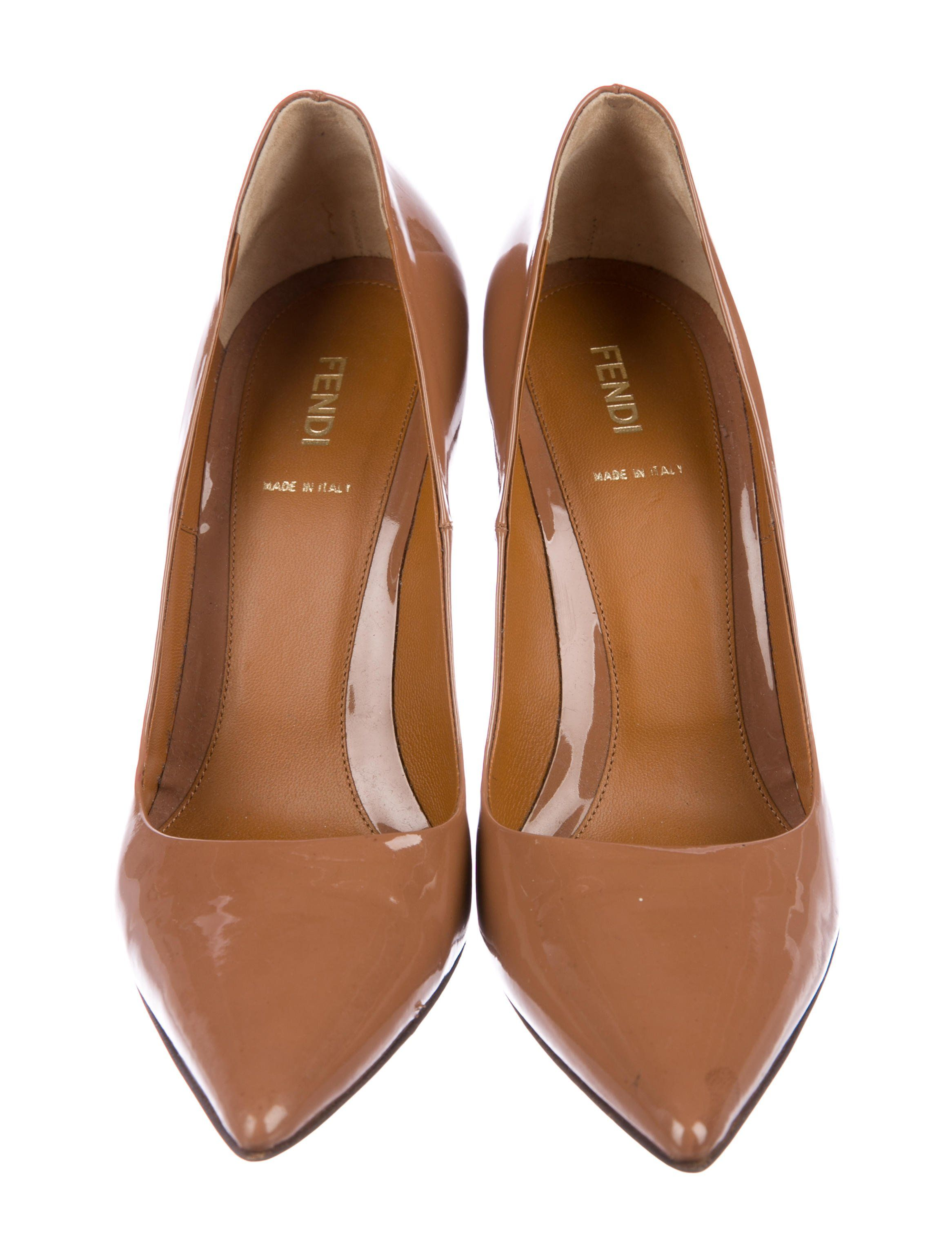 d1fb1e49c0 Caramel patent leather Fendi pointed-toe pumps with tonal stitching and  stacked heels.