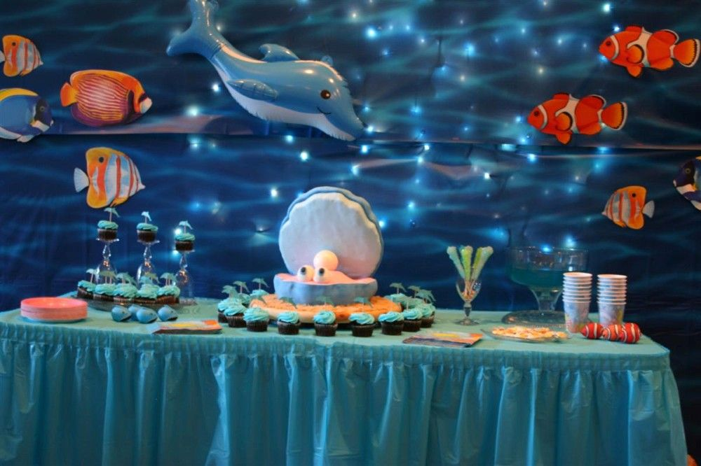 Icicle lights behind cheap blue tablecloths awesomeness for Sea themed decorating ideas