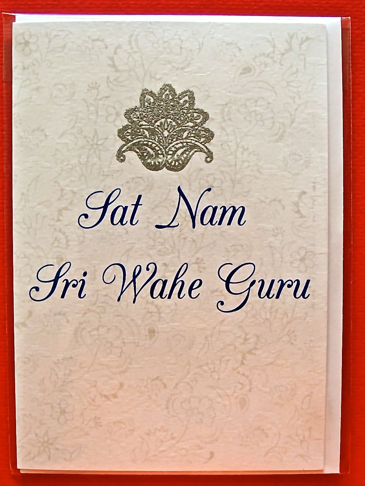 A Simple And Elegant Greeting Card With The Words Sat Nam Sri Wahe