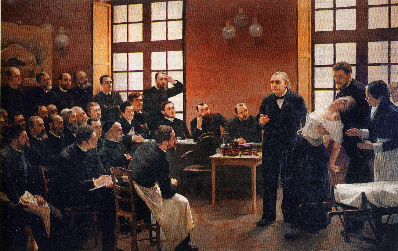 """Una lección clínica en el Salpetrière (""""Une leçon clinique à la Salpêtrière""""). André Brouillet. 1887. Localización: Université Paris 5 René Descartes https://painthealth.wordpress.com/2015/11/09/una-leccion-clinica-en-el-salpetriere/"""