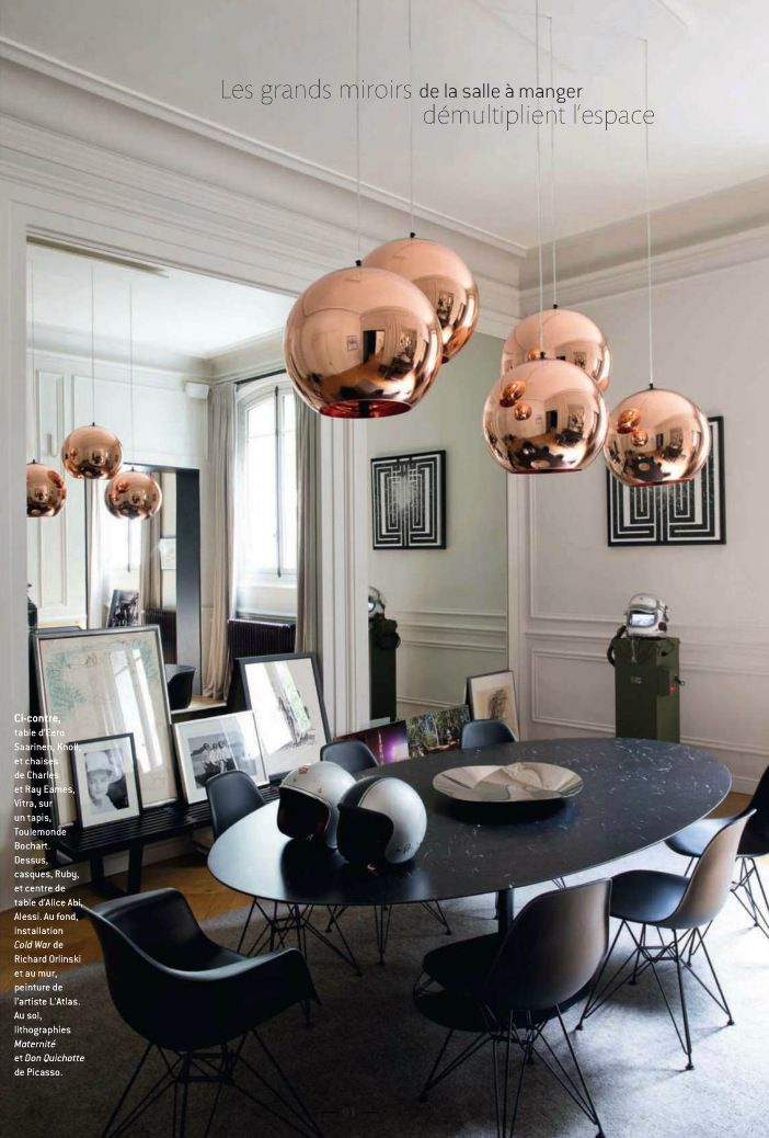 I love the use of these hanging copper orbs.This detail is an element that has its roots in Mid Century design.