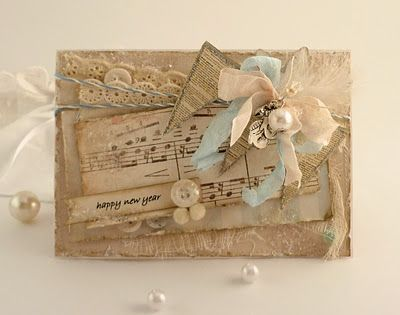 Combination of paper and sewing for this beautiful new years card.