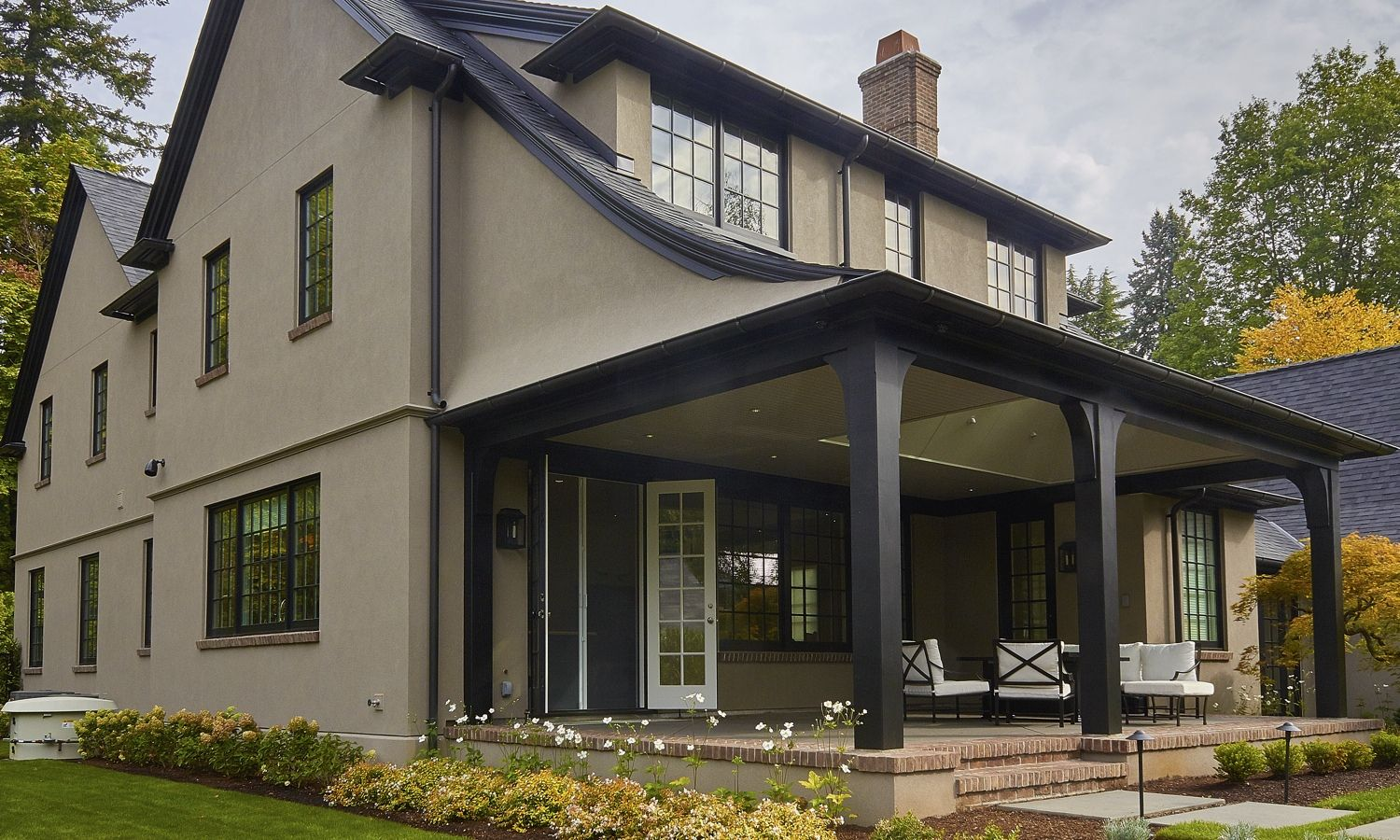 This new tudor revival styled home situated in portland 39 s - Tudor revival exterior paint colors ...