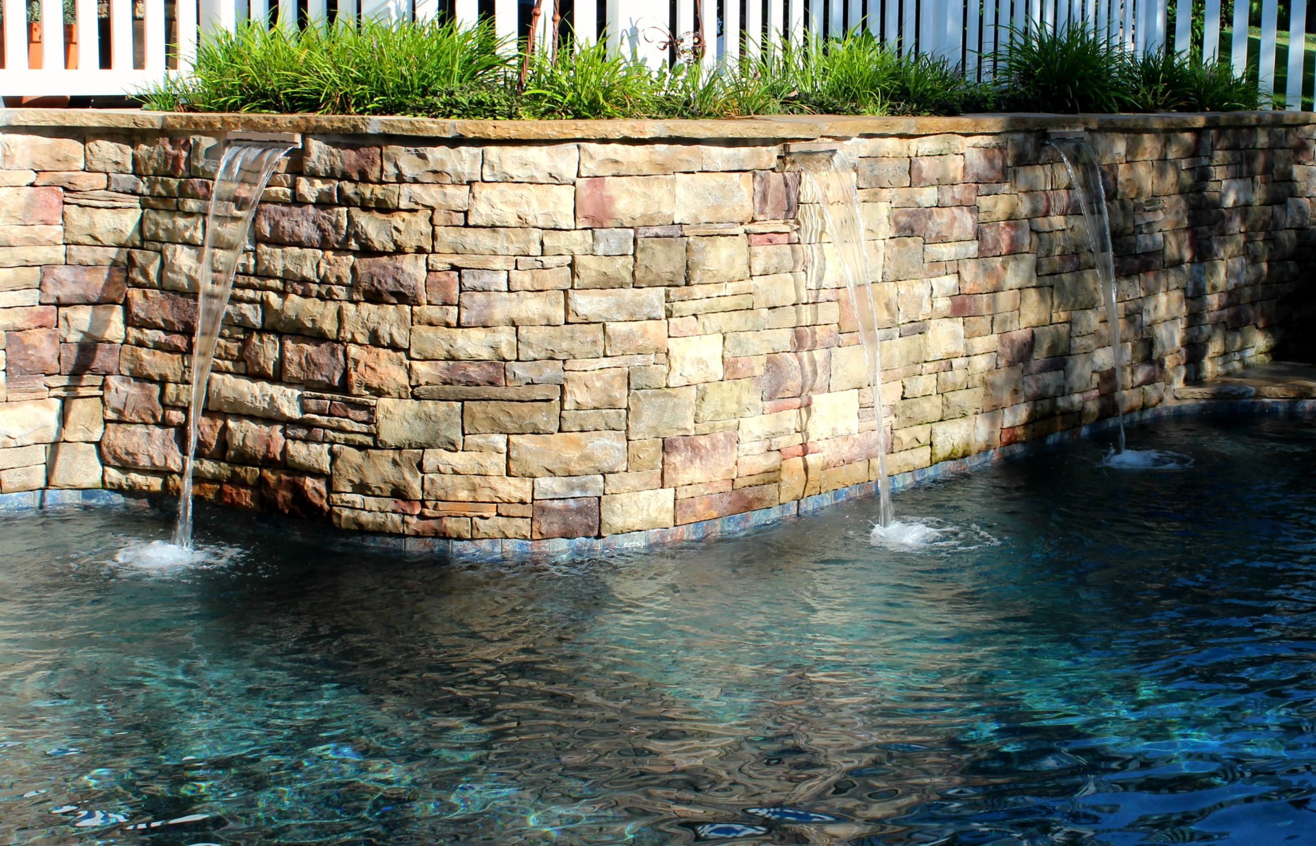 Sheer Wall Descent Features On A Gunite Concrete Pool, With Custom Stone  Retaining Wall.