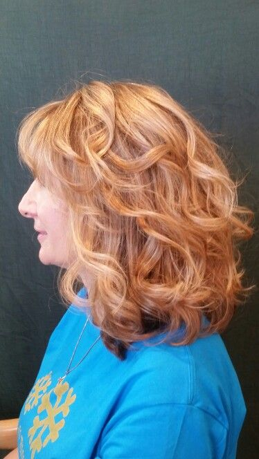 Beachy waves with 3 shades of blonde.