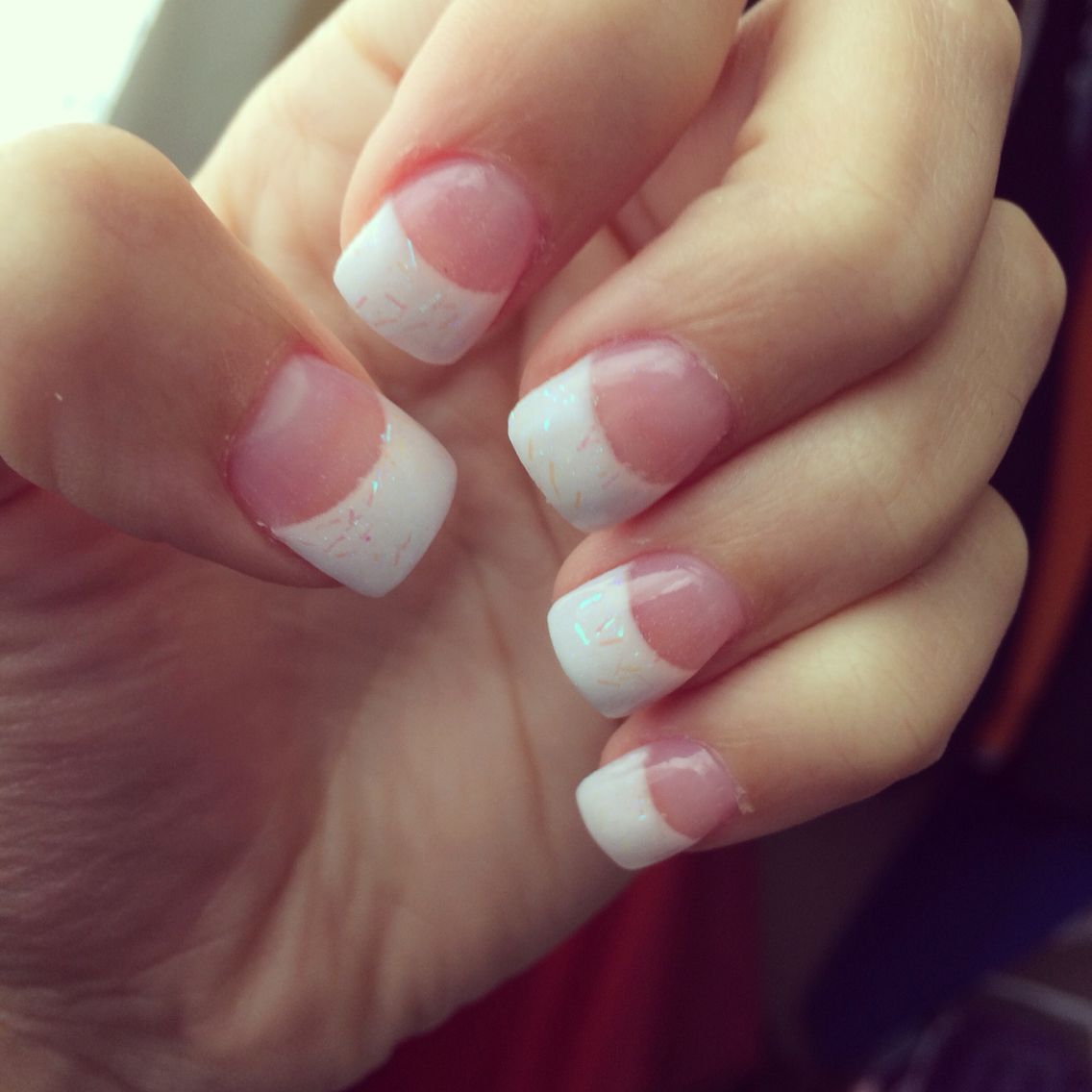 Sparkly French tip acrylic nails quite a bit shorter than I like but ...