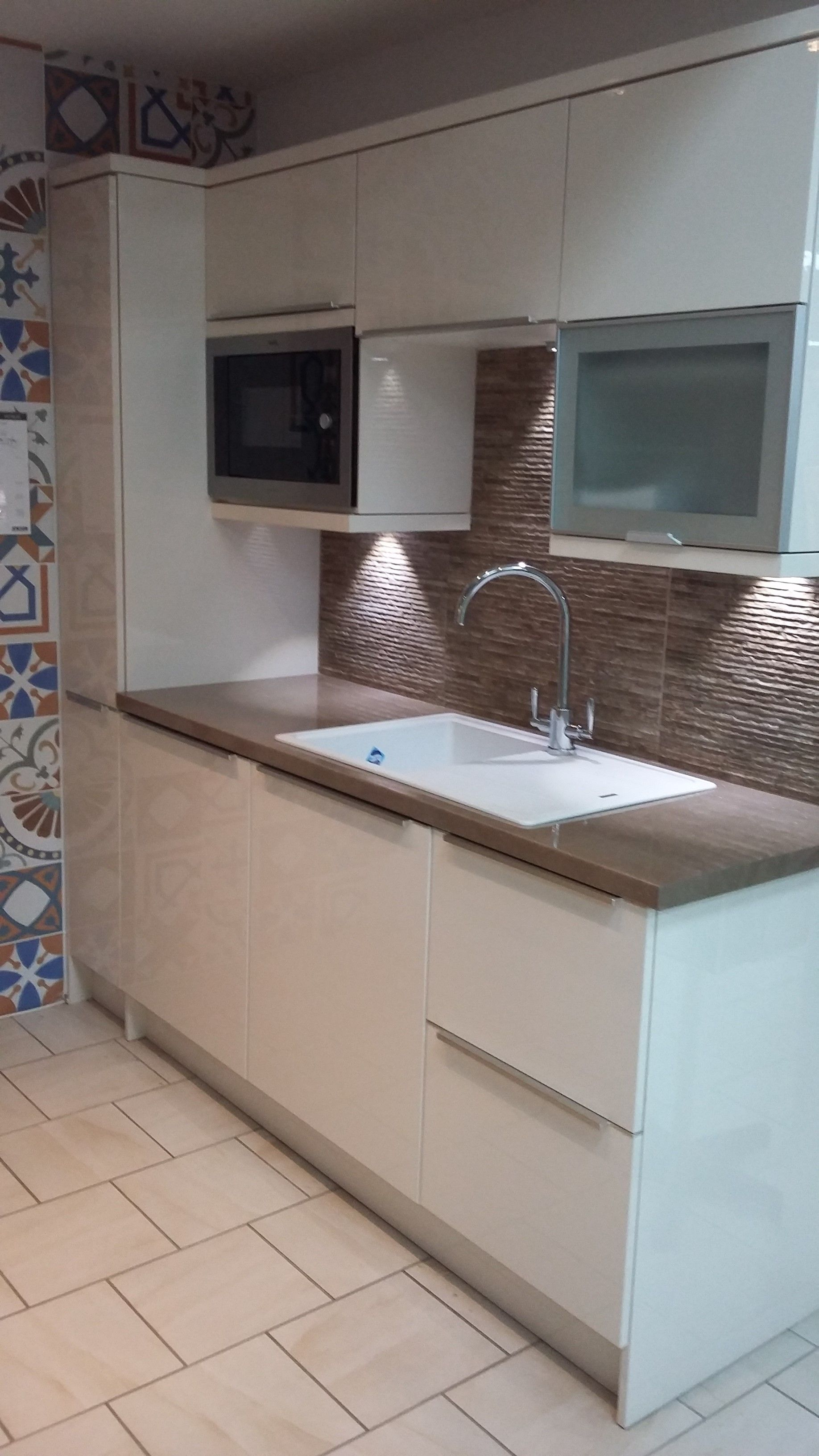 BY DESIGN Metra Gloss Ivory Kitchen with Omega Sandstone Quartz
