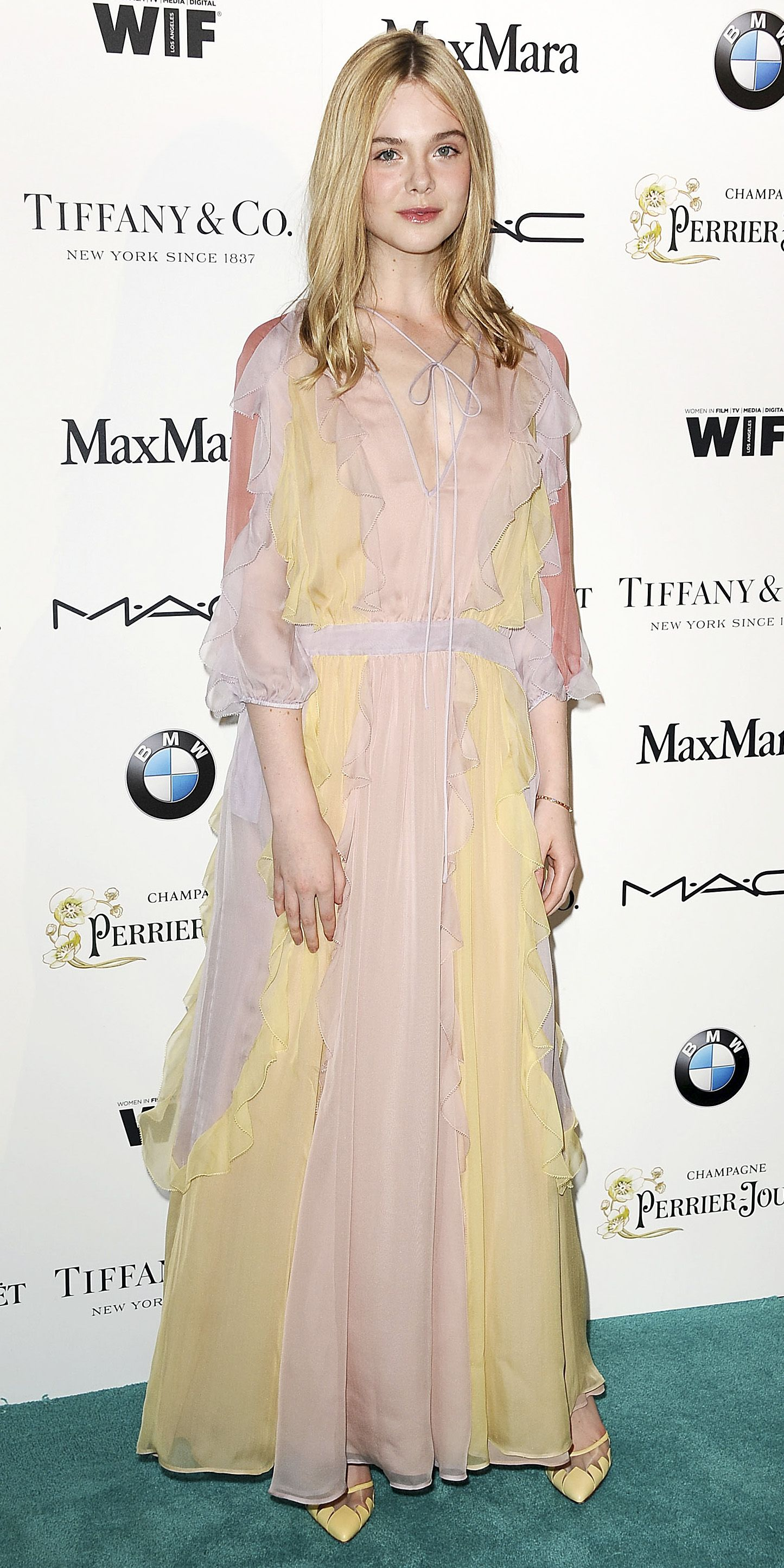 Elle Fanning'sRed Carpet Style - In Valentino, 2015 from InStyle.com